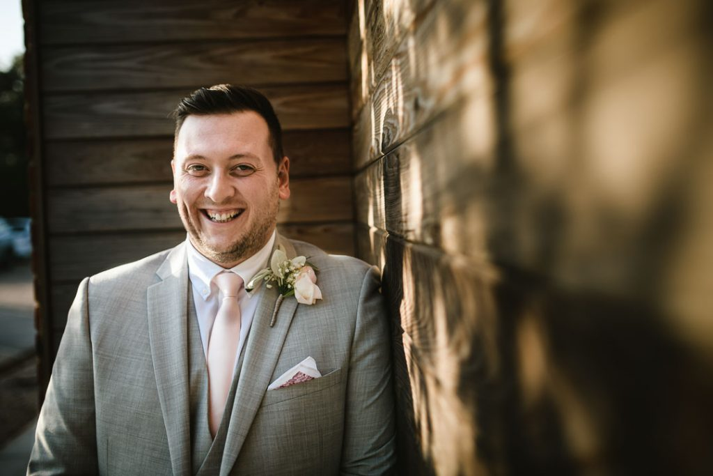 groom smiling at camera
