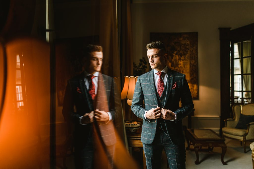 groom in checked blue suit