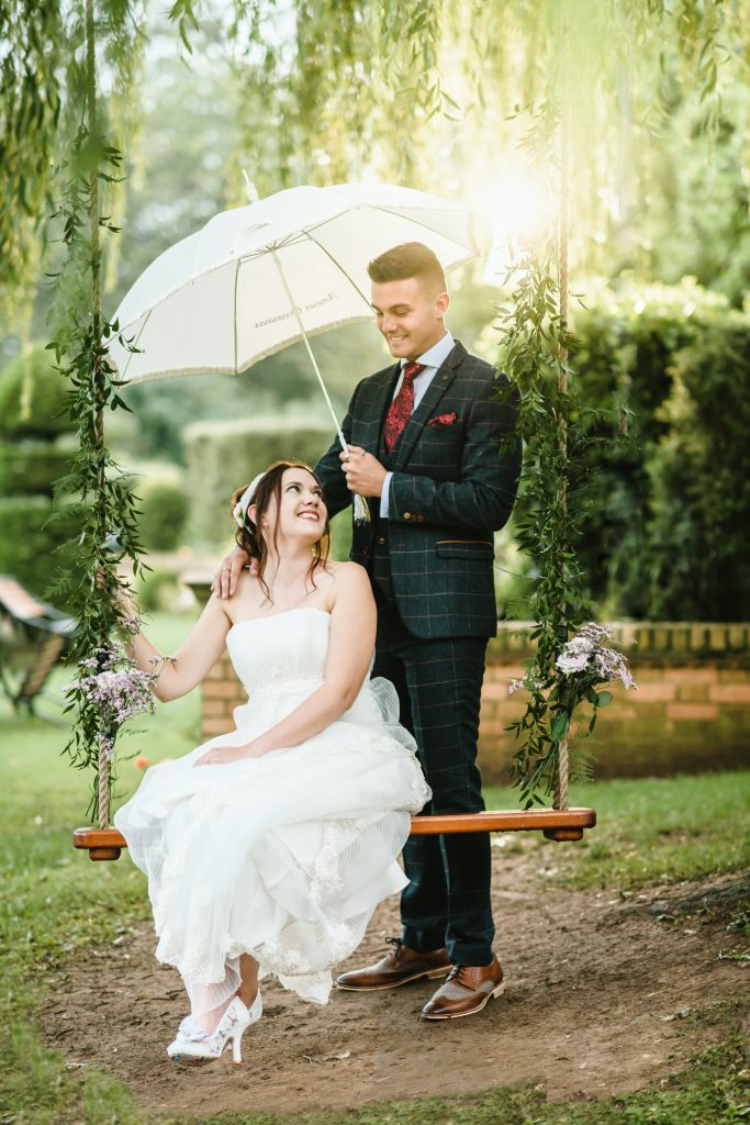 bride sat on swing at hemswell court wedding