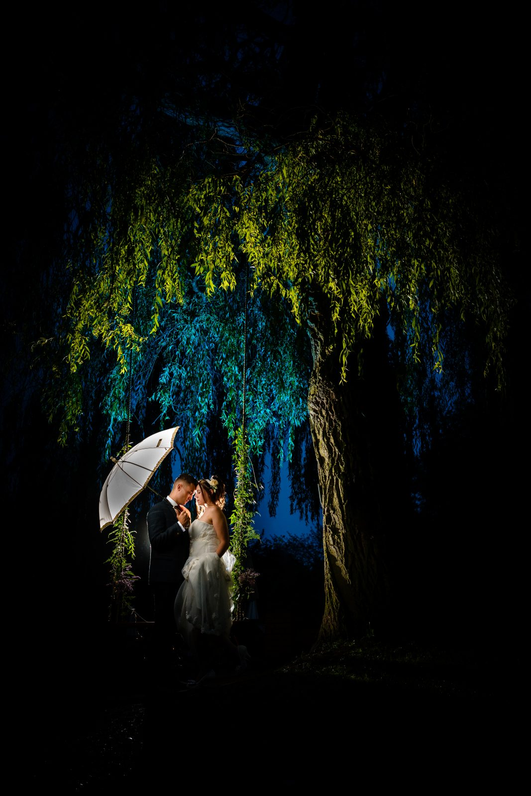 bride and groom on swing at hemswell court wedding