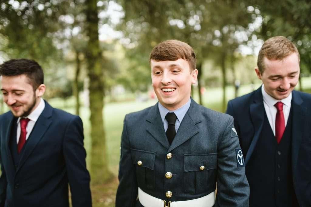 groom waling with groomsmen