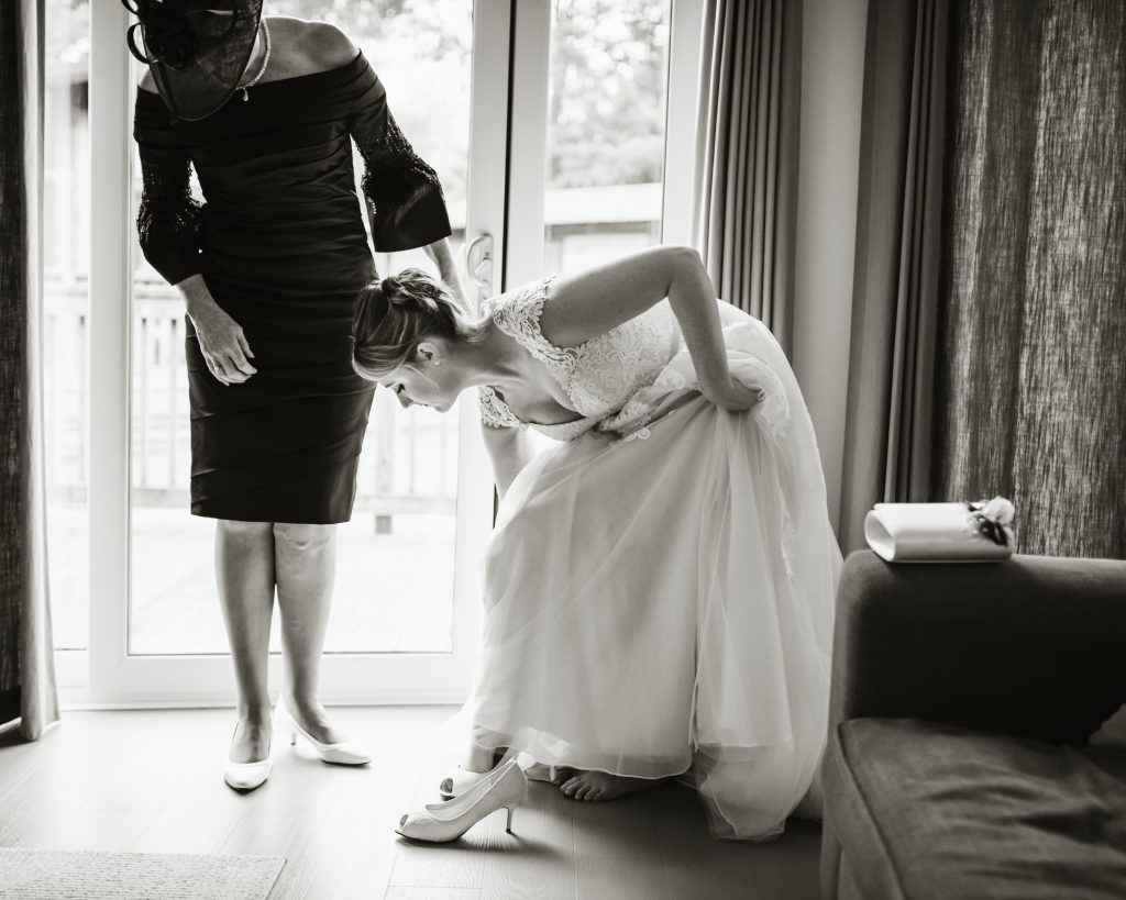 bride placing her shoes on
