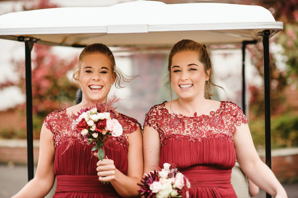 bridesmaid riding on golf cart