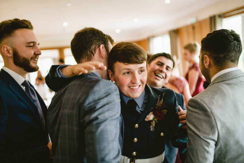 groom smiling at wedding
