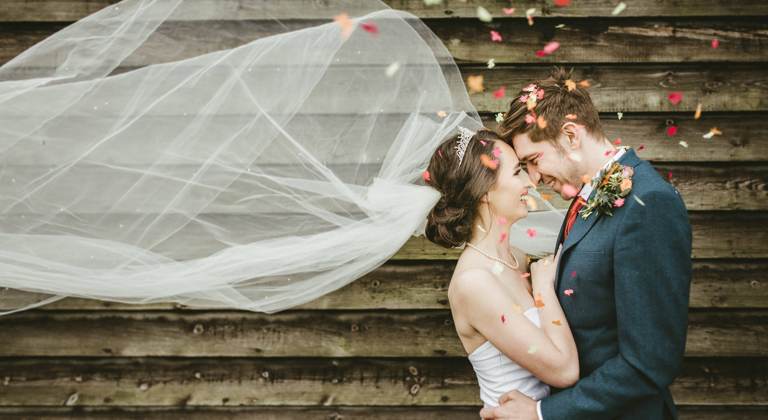 bride and groom with confetti by lincolnshire wedding photographer