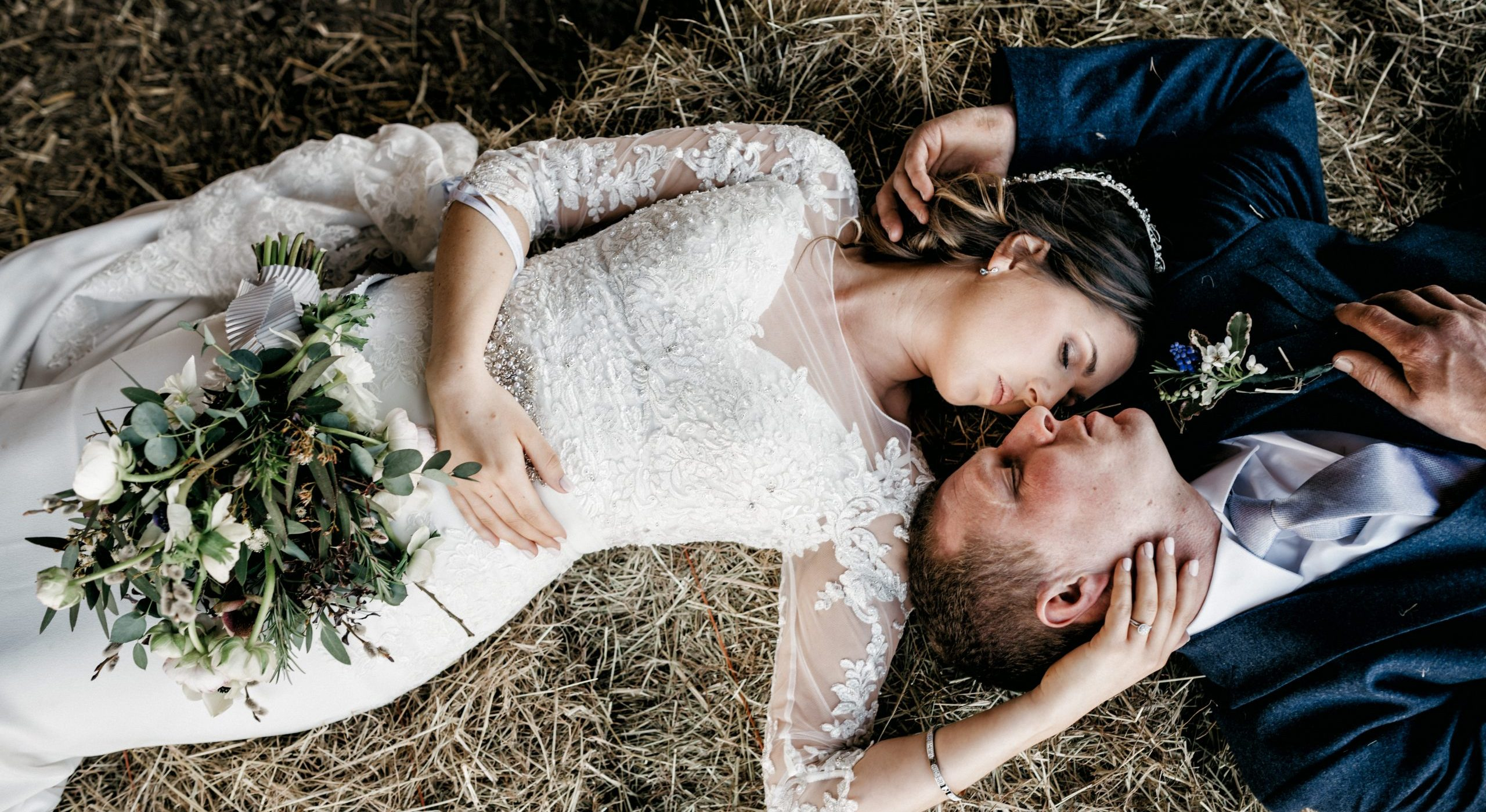 bride and groom lying down at dower house wedding
