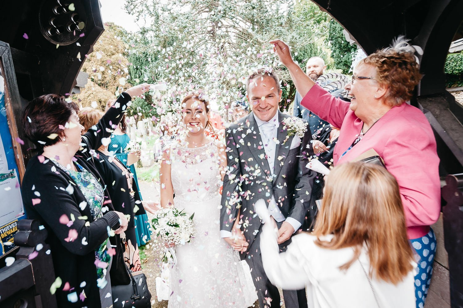 confetti thrown at bride and groom