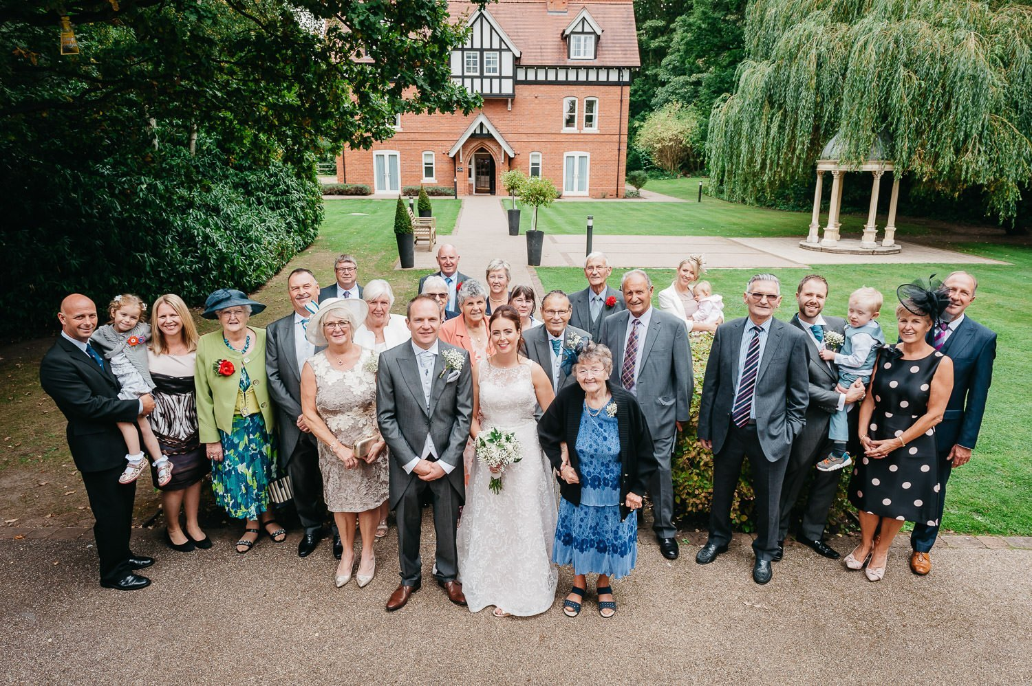 group photograph at a dower house hotel wedding