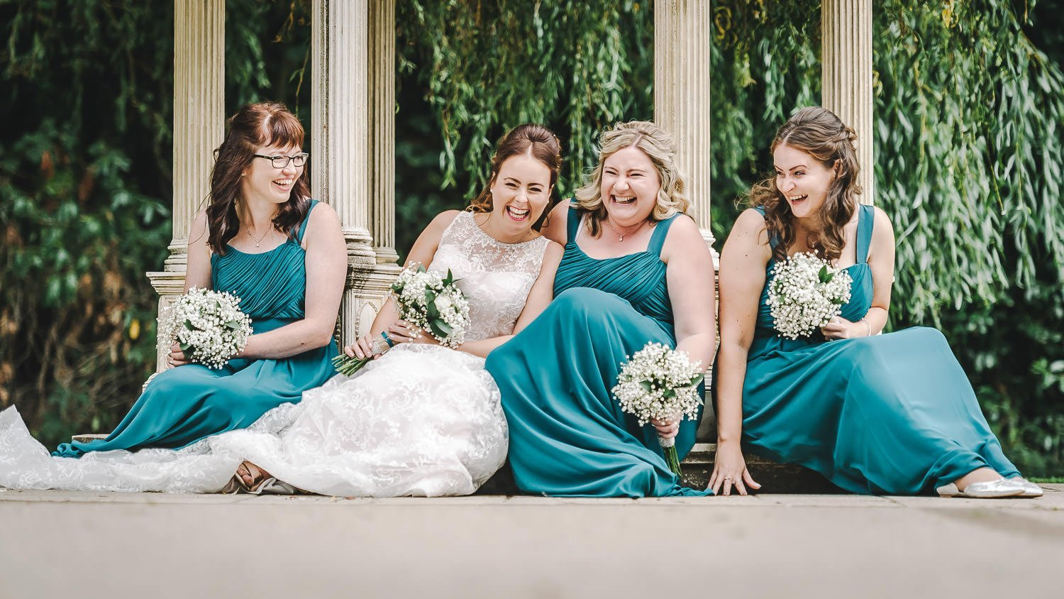 bridesmaid on floor laughing at dower house hotel wedding
