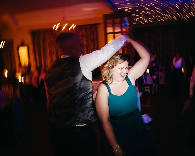bridesmaid dancing at dower house hotel wedding
