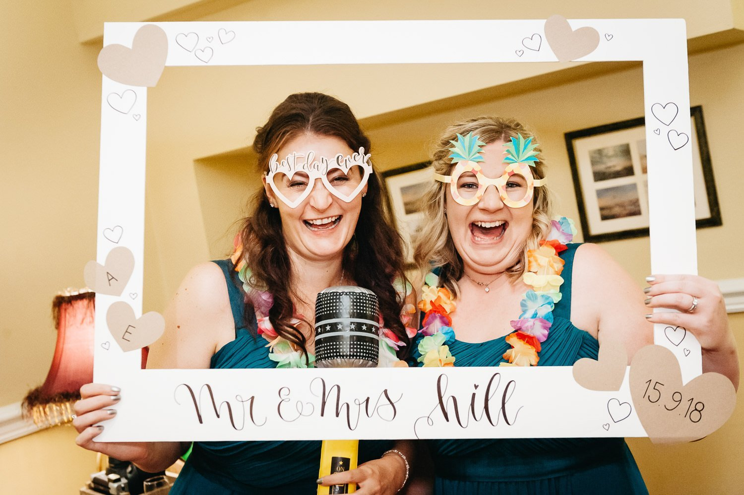 bridesmaids holding up sign at dower house hotel wedding