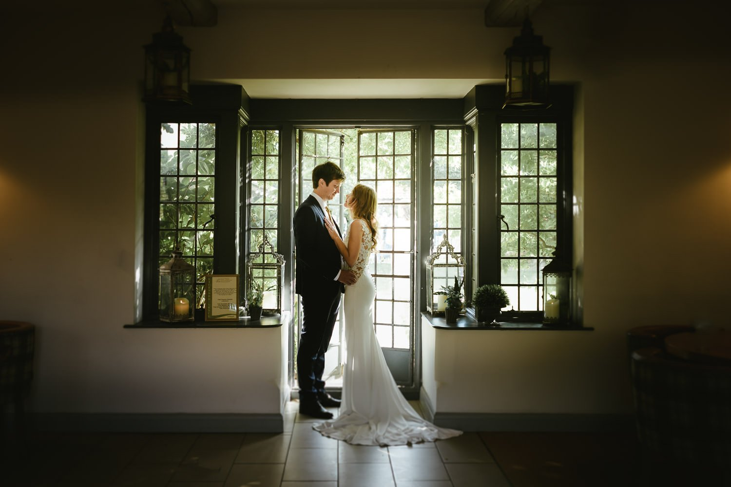 bride and groom stood facing inside Doddington Hall