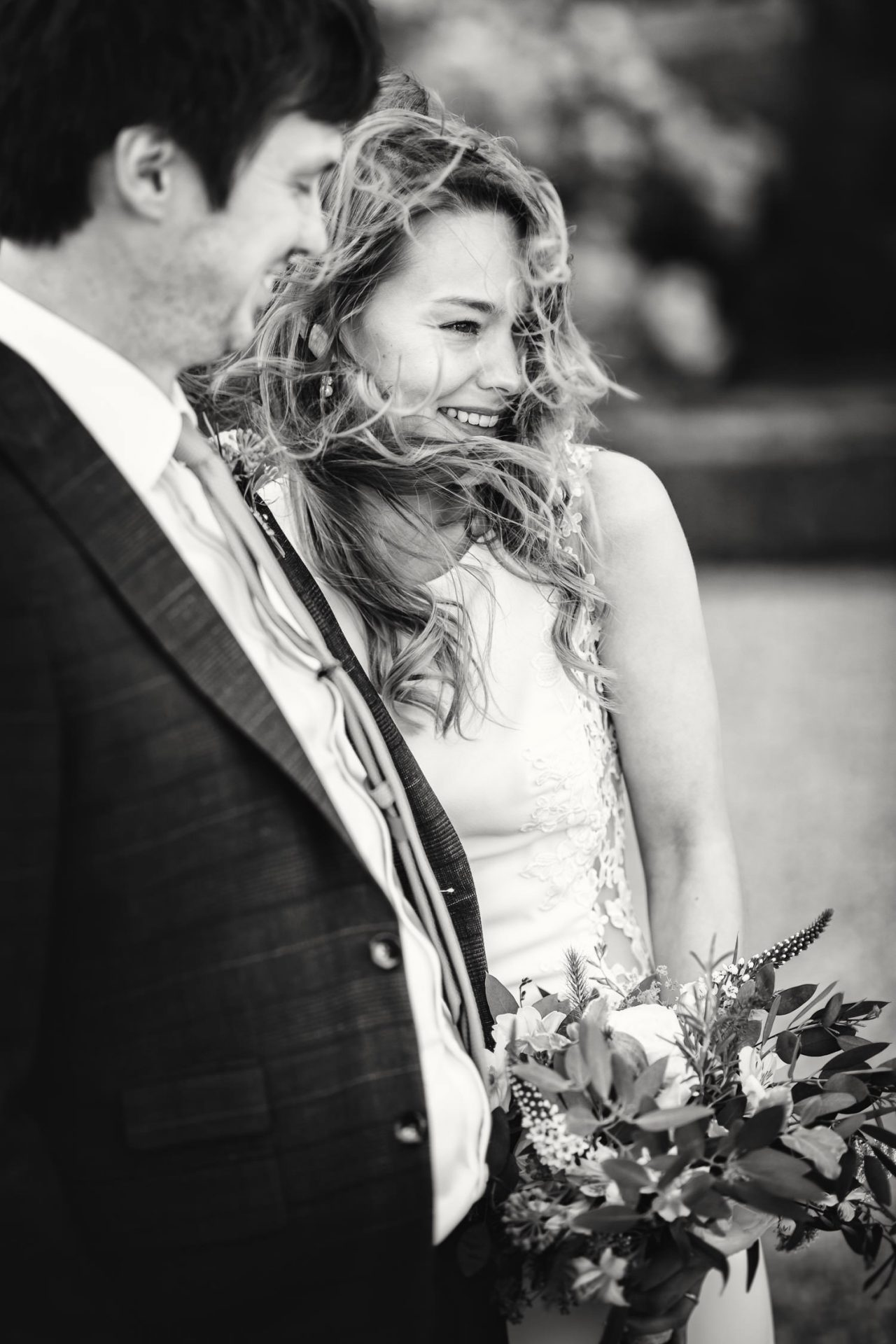 bride laughing with groom at Doddington Hall wedding
