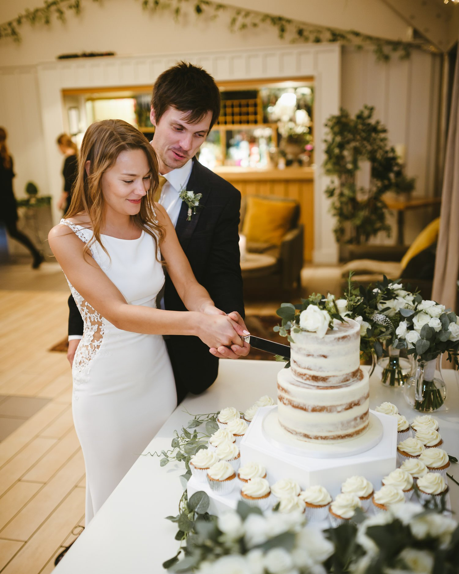 bride and groom cut wedding cake at Doddington Hall