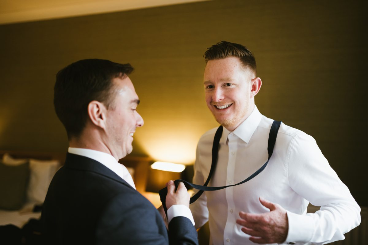 groom putting on braces