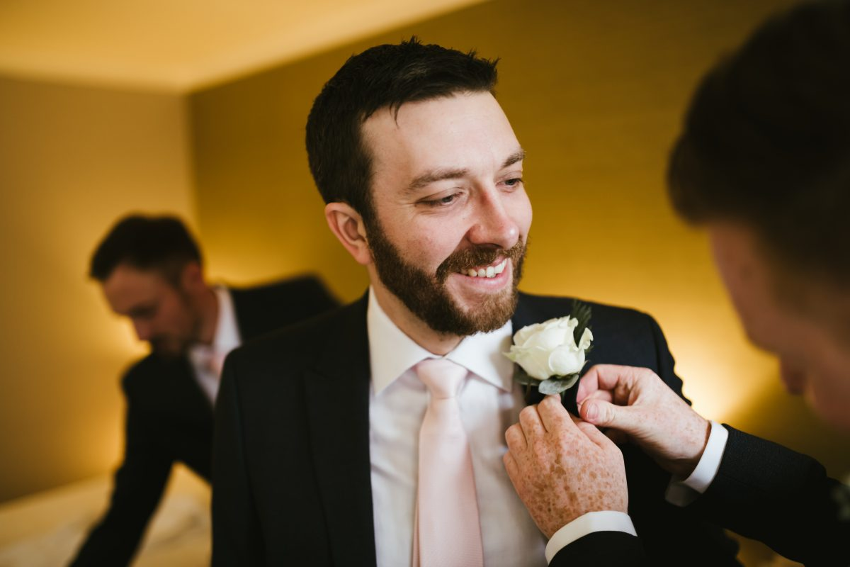 bestman with flower on suit