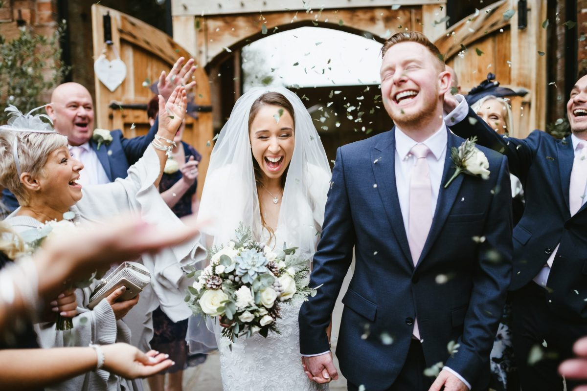 bride and groom with confetti at shustoke barn