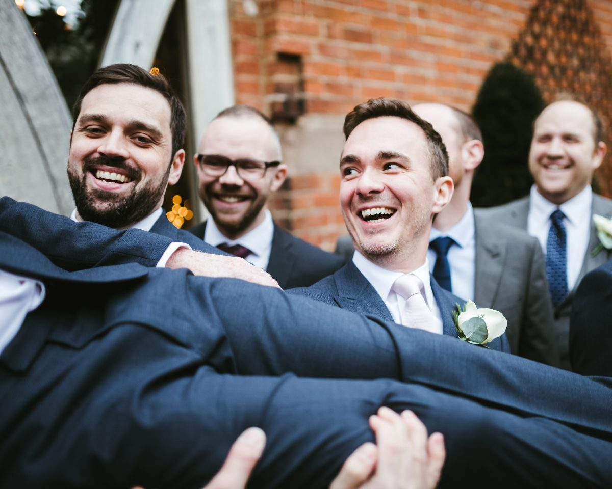 bestman holding onto groom