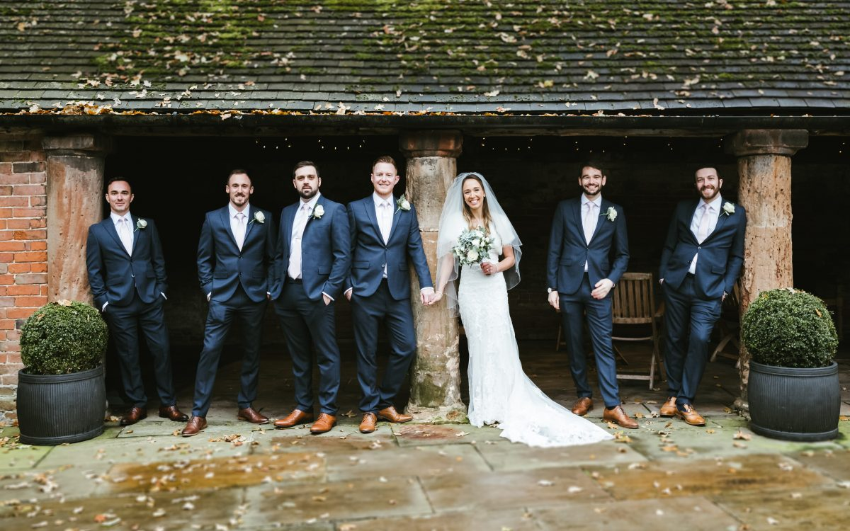 wedding group stood inside barn