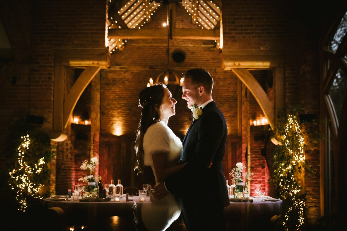 bride and groom facing each other at shustoke barn wedding