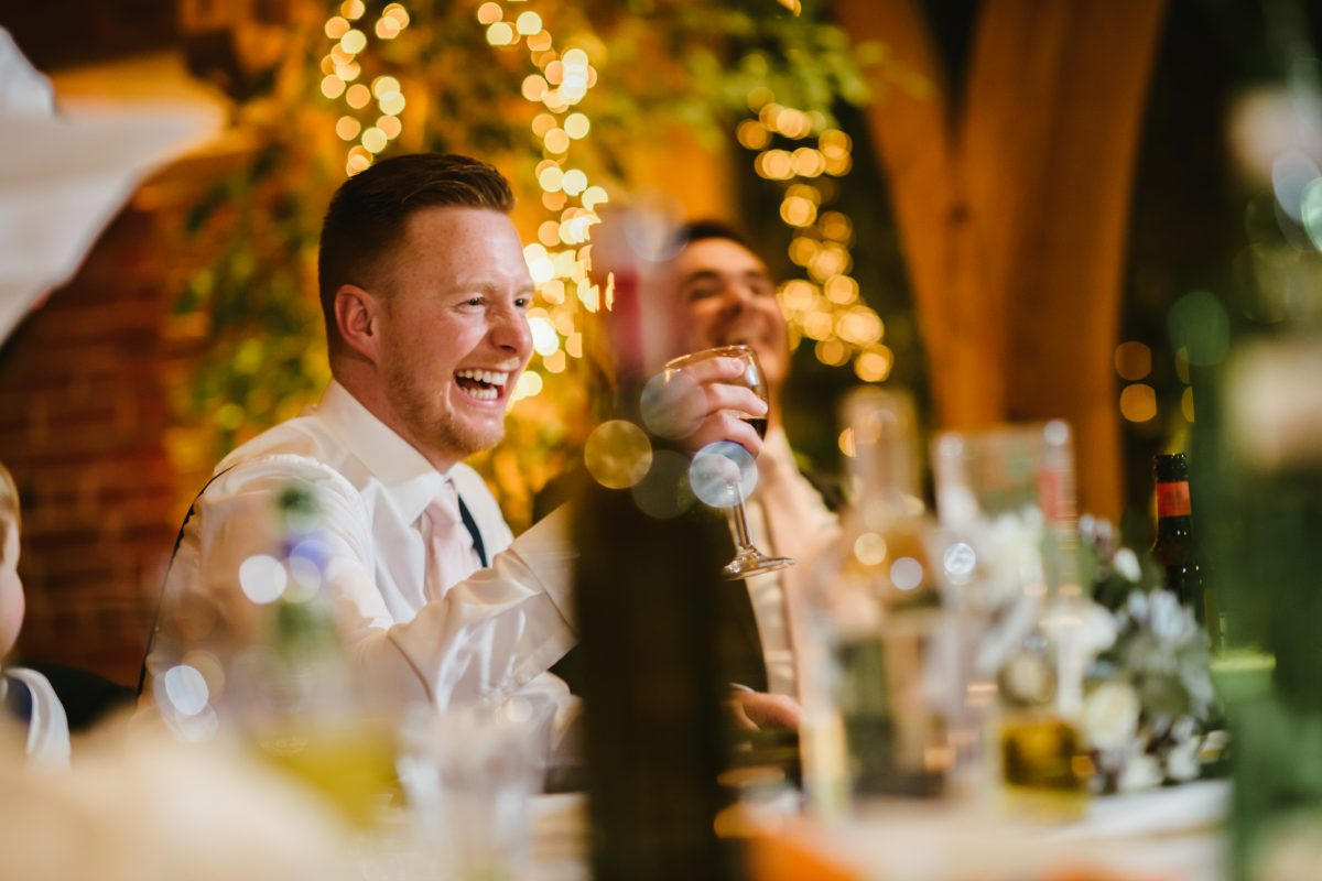 groom sat laughing