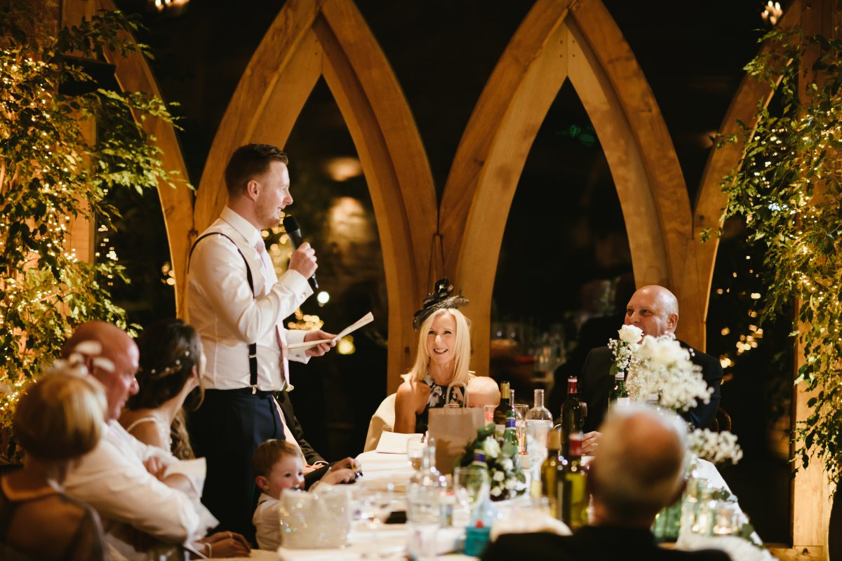 groom stood giving speech at shustoke barn