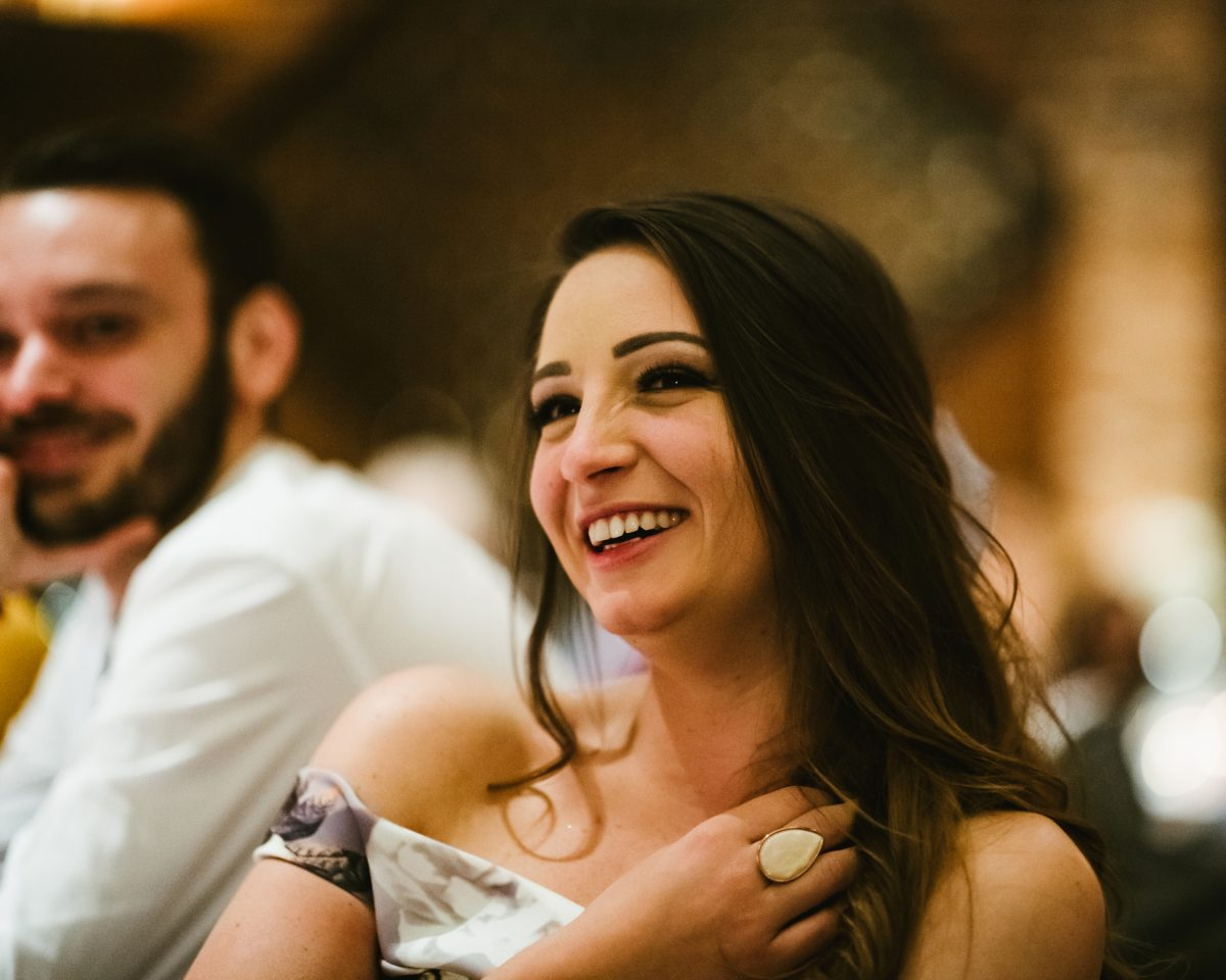 woman laughing at shustoke barn wedding