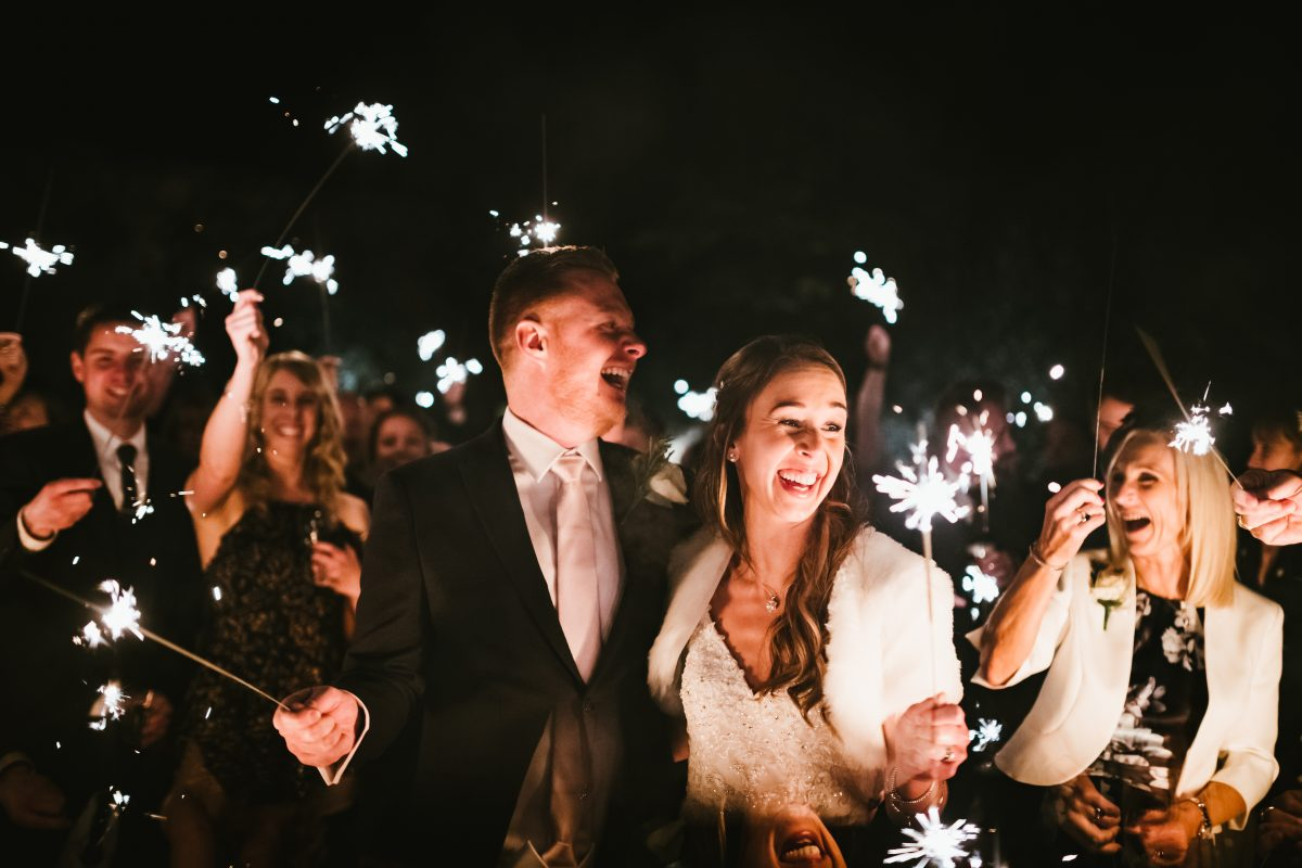 bride and groom holing sparkler at shustoke barn
