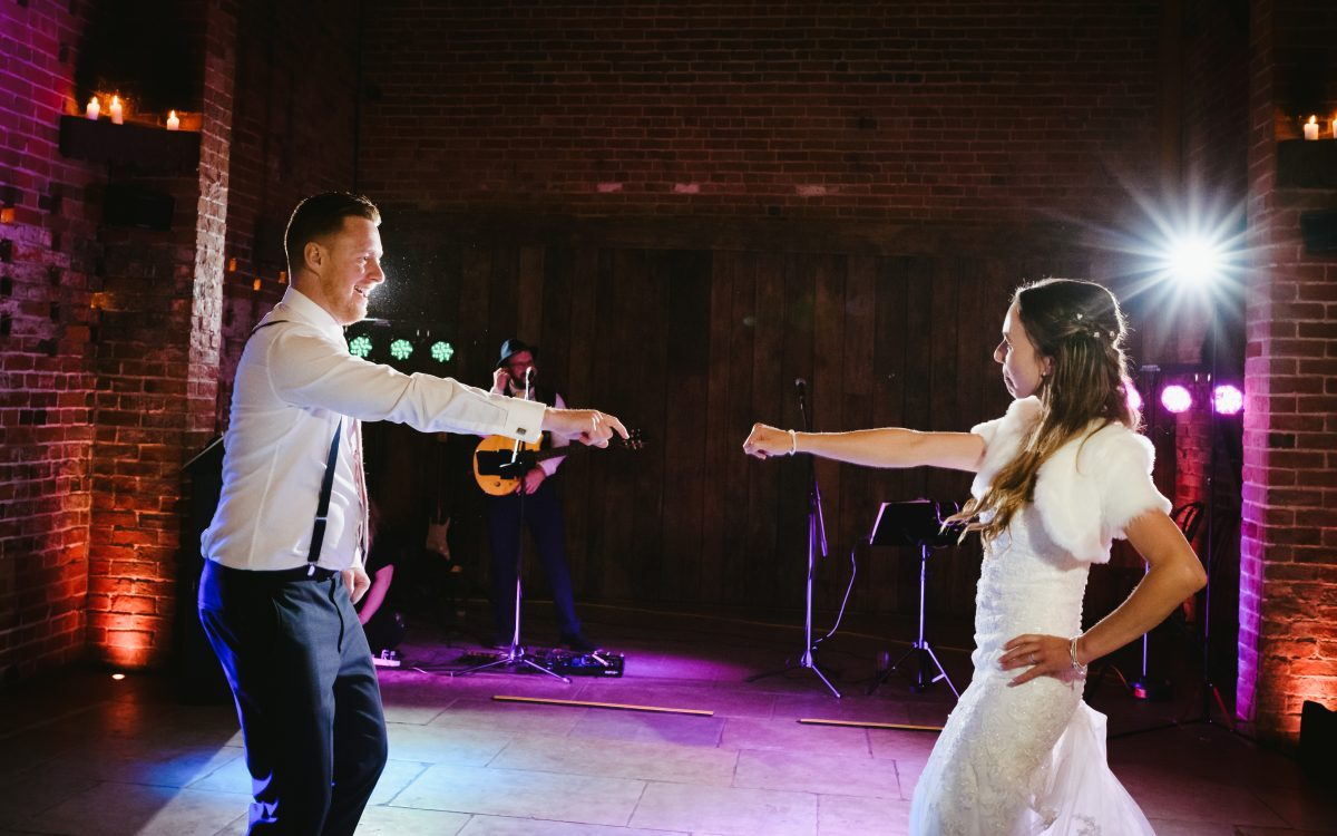 bride and groom dancing in shustoke barn wedding