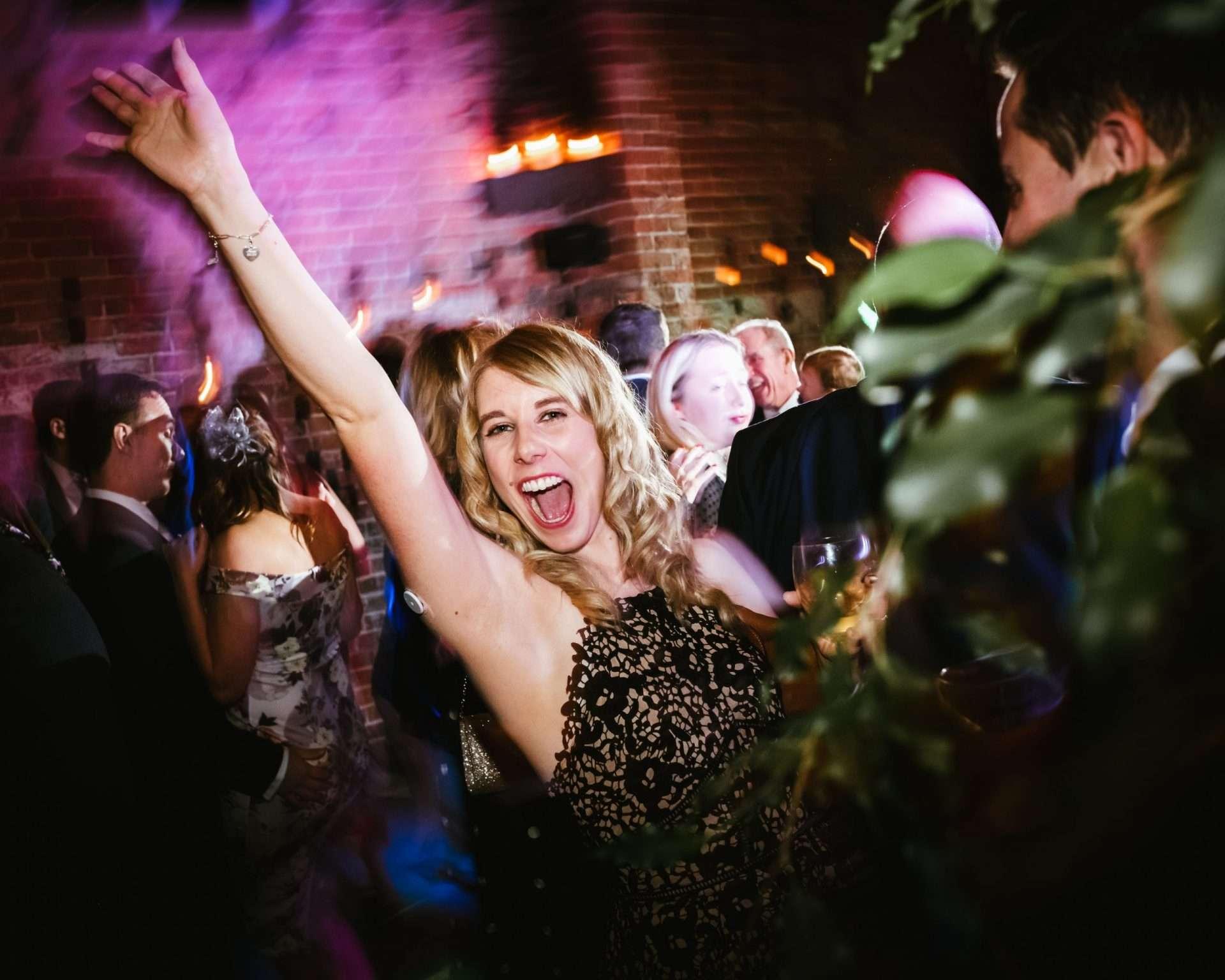 woman dancing at shustoke barn wedding